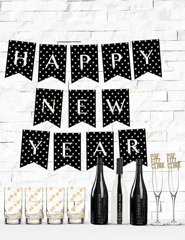 free printable gold glitter polka dot happy new year banner from chicfetti freeprintable nye