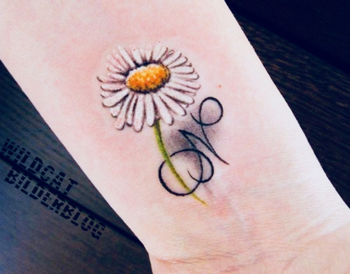 Pin by LYNN RUBBO on INKED.. Daisy tattoo