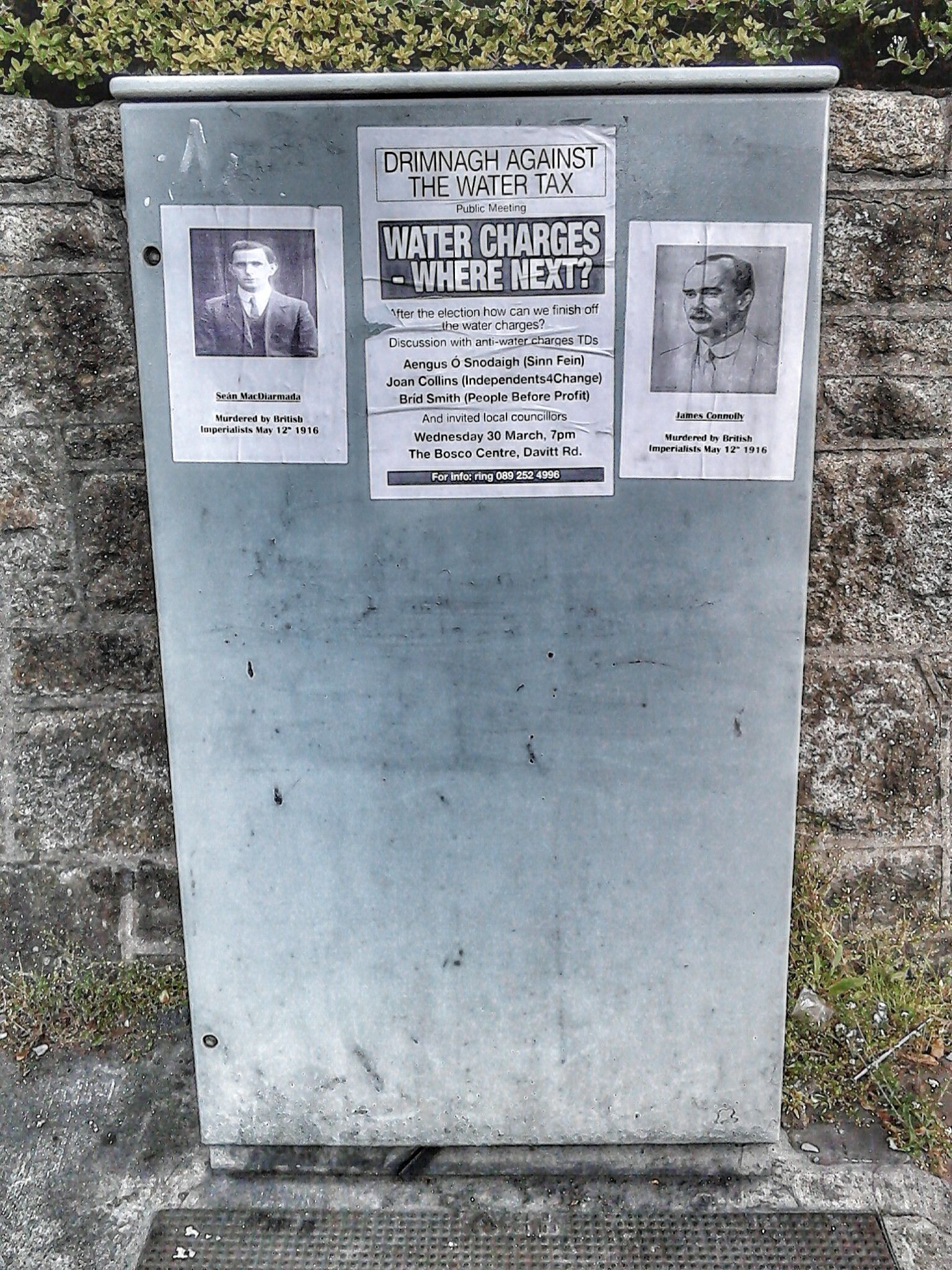 Posters of executed 1916 leaders on an electrical supply box, Crumlin Road, Dublin.