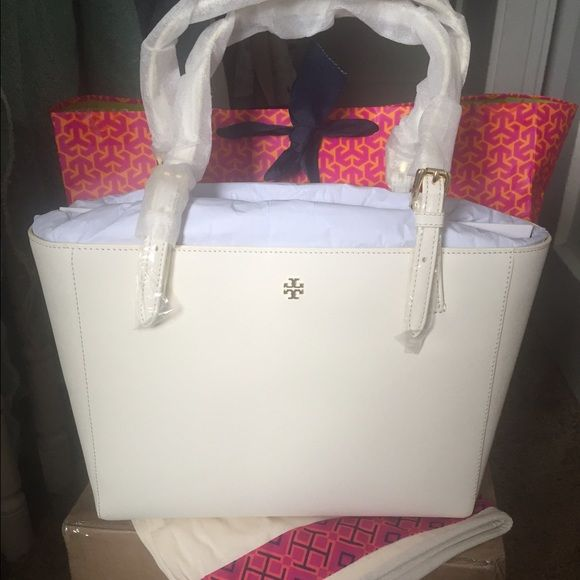 NWT Tory Burch York Brand new with tags Tory Burch York tote small in new ivory color. Retail is $245+tax. no trades on this. Come with dustbag and is available on ♏️ercari for a cheaper, just ask. Tory Burch Bags Totes