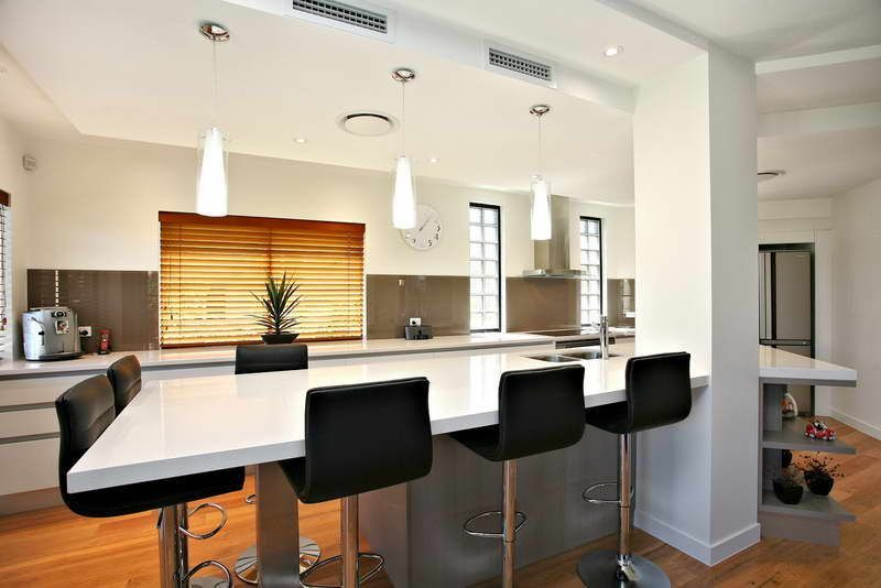 open galley Open Galley Kitchen With Modern Chairs #opengalleykitchen open galley Open Galley Kitchen With Modern Chairs #opengalleykitchen