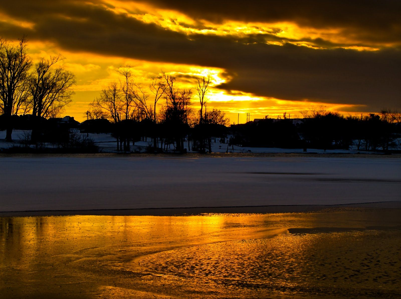 Golden sunset with ice water snow reflection jacobson