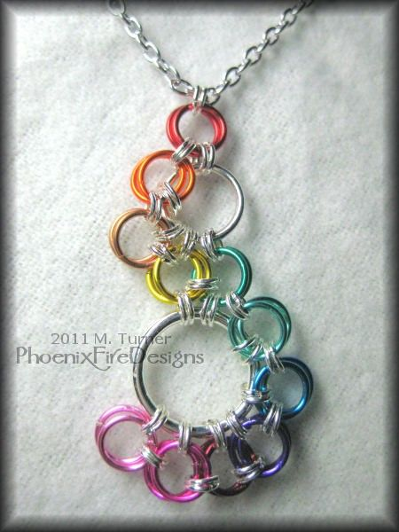 Rainbow stepping stone chainmail pendant.  I wonder if there is a way to make the chaining neater than it already is.