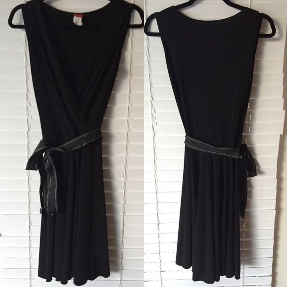 Sleeveless black dress with ribbon waist tie Adorable black dress. V neck, black ribbon with white stripe for waist. Can be changed out for a different ribbon of your preference! 92% polyester and 8% spandex. Dresses