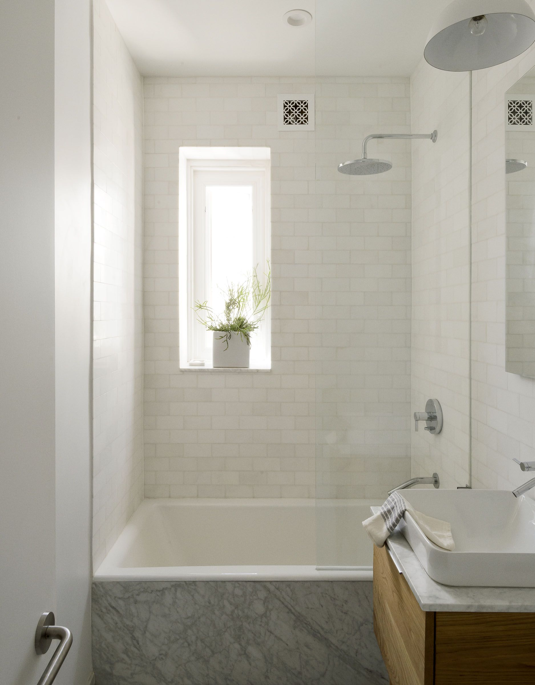 Compact Marble Tiled Bath In Jacqueline Schmidt And David Friedlander S 675 Square Foot Brooklyn Quarters Matthew Williams Photo Remodelista