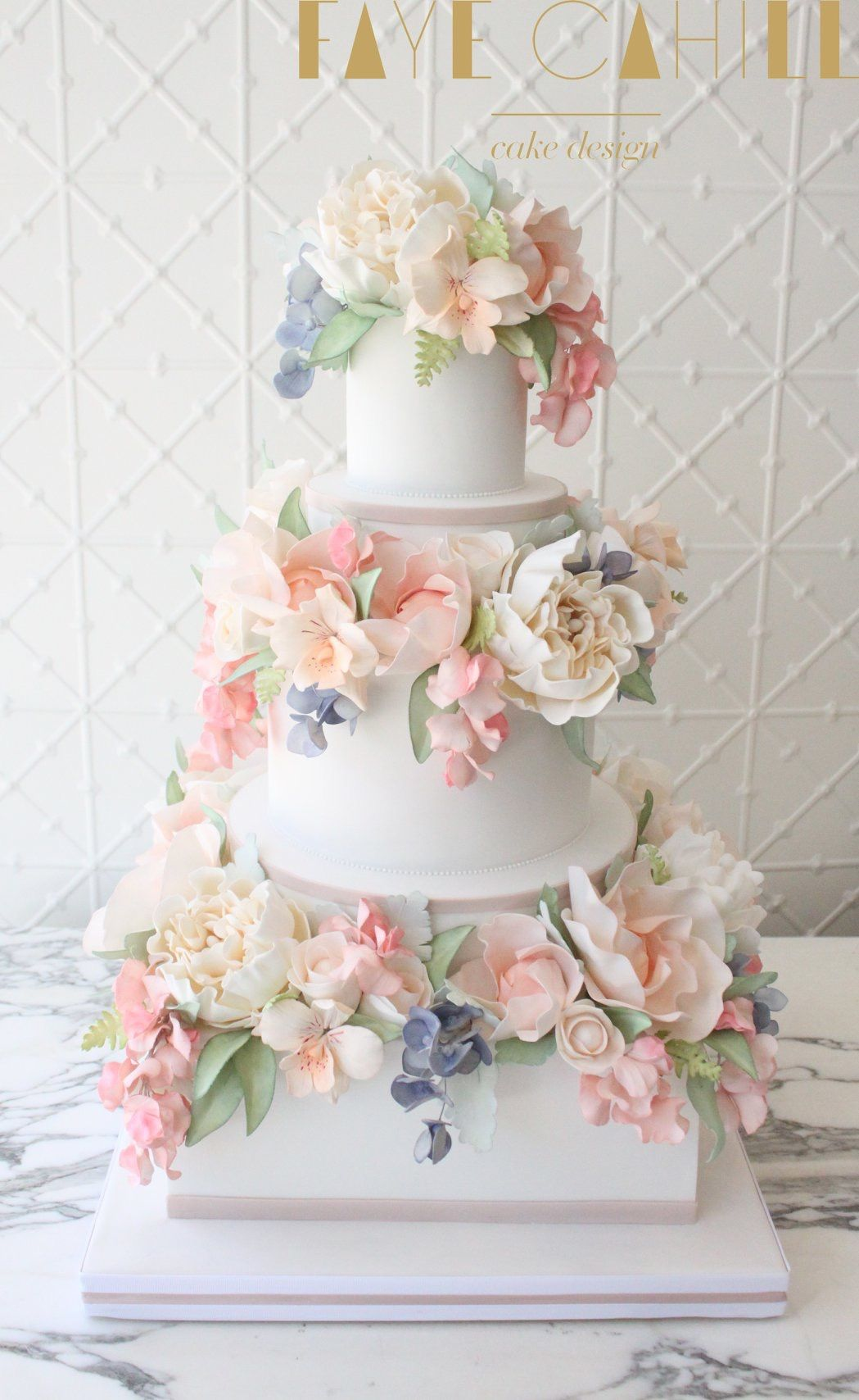 This absolutely gorgeous cake covered with beautiful sugar flowers