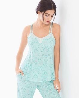 Fun and flirty swing pajama cami is trimmed all around the neckline in lace in customer favorite Cool Nights fabric. Double fabric straps at front, adjustable elastic at back. Cool Nights breathable fabric keeps you cool and dry and retains its shape and silky drape, even after countless washings.