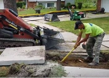 Section of sidewalk removed to install a French Drain in ...