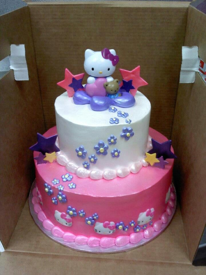 Whipped icing hello kitty tired cake with airbrushing and gumpaste