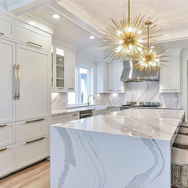 Marble waterfall countertops and statement pedant lights | Spectacular Kitchen | White and gold #ModernHomeDecorKItchen #waterfallcountertop