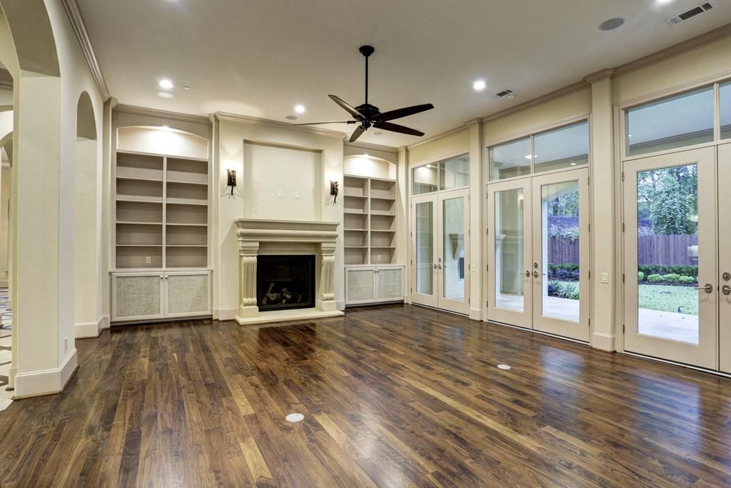 Den located off of two-story foyer features gas fireplace with ...