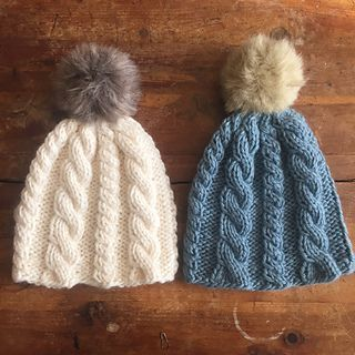 af767a43cb310 Knit this easy cabled hat and add a fun pom pom!