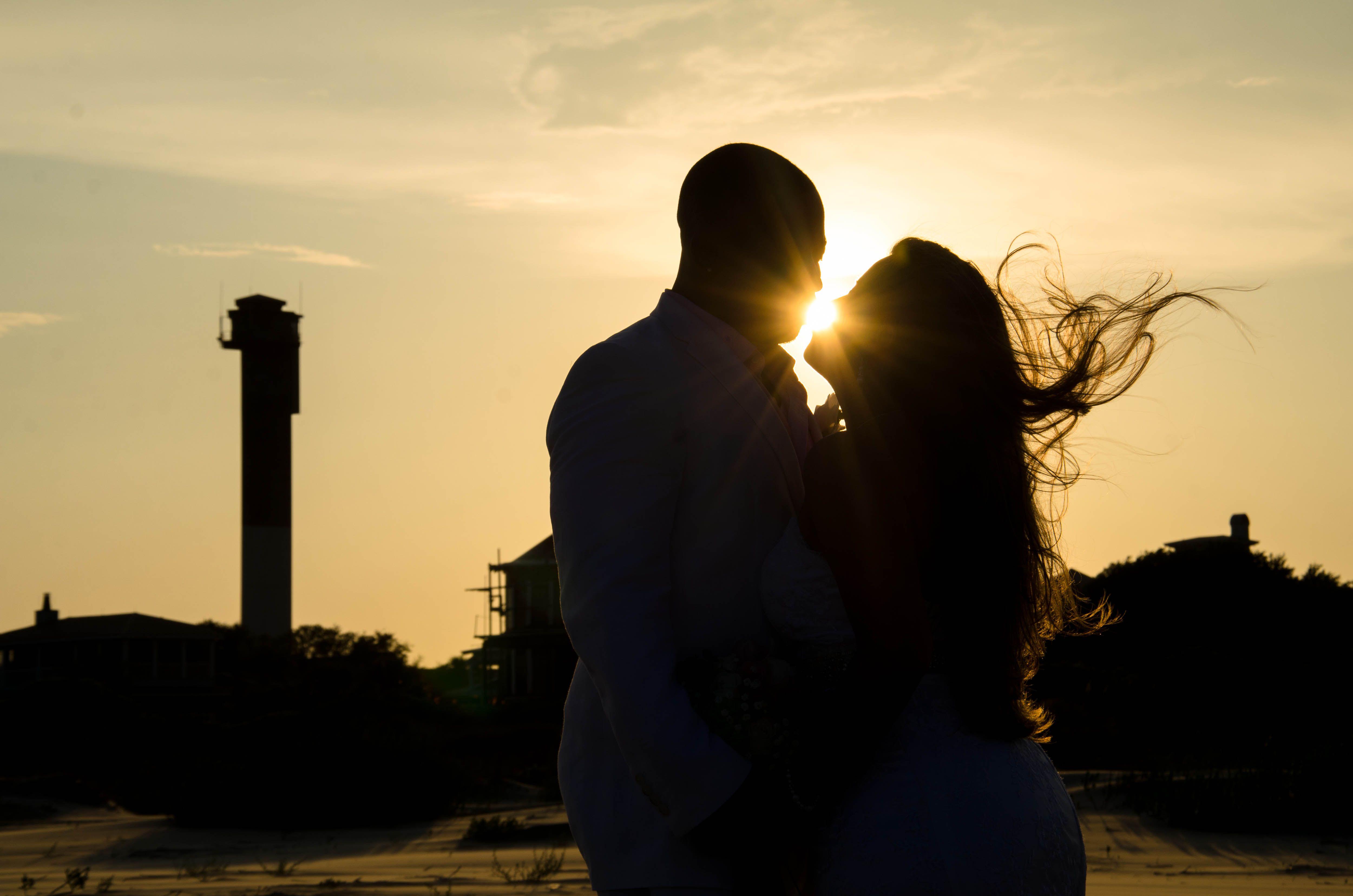 Capturing the sun between the newlyweds... sunset beach