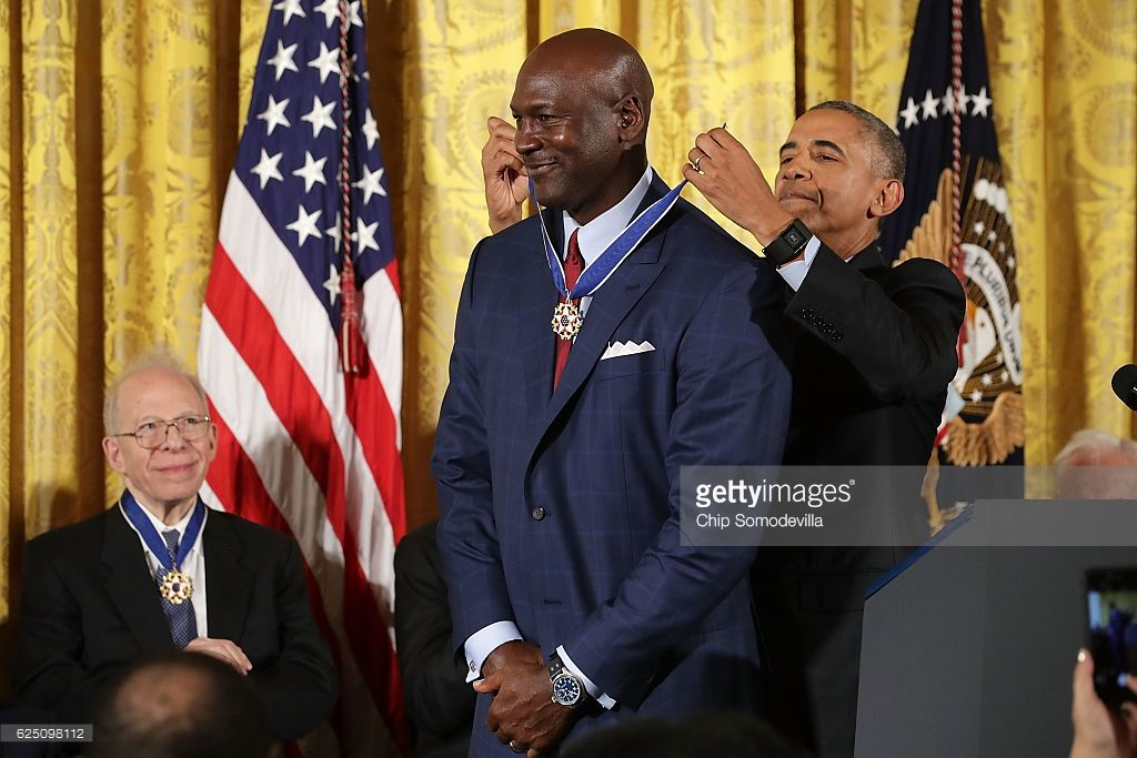 U.S. President Barack Obama awards the Presidential Medal of Freedom to National Basketball Association Hall of Fame member and legendary athlete Michael Jordan during a ceremony in the East Room of the White House November 22, 2016 in Washington, DC. Obama presented the medal to 19 living and two posthumous pioneers in science, sports, public service, human rights, politics and the arts.