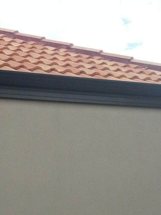 terracotta roof tiles and grey solver