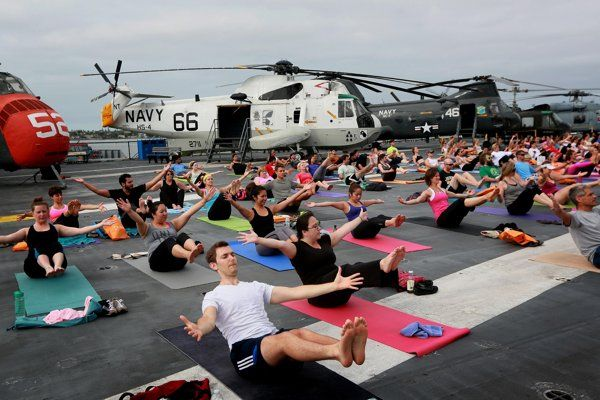 How cool is this? Around 400 people participated in a yoga session on the flight deck of the USS Midway Museum in San Diego on July 12, 2014.