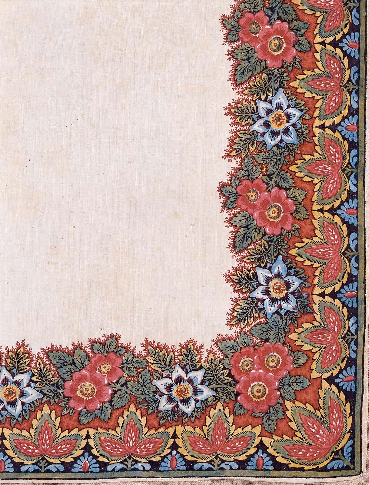 Stout muslin ground. Main field is plain. Wide border showing red roses and blue daisies (?) and a narrower outer border showing conventionalized red, green and yellow blossoms and blue daisies. Wood block print. Cotton browned and stained.