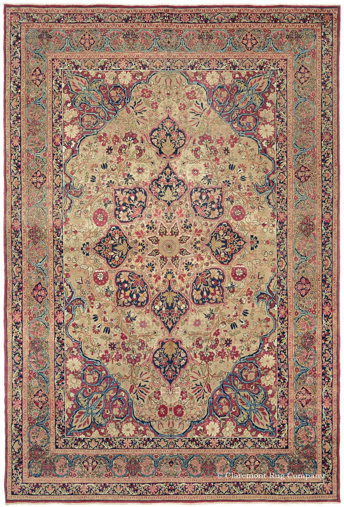 LAVER KIRMAN - Southeast Persian, 7ft 10in x 11ft 5in, Circa 1875. The Roman couple's collection of antique court carpets includes this stellar representative of one of the most important classical styles - Laver Kirman. From its mesmerizing center medallion to its virtuoso borders, all of the motifs have an etched quality.