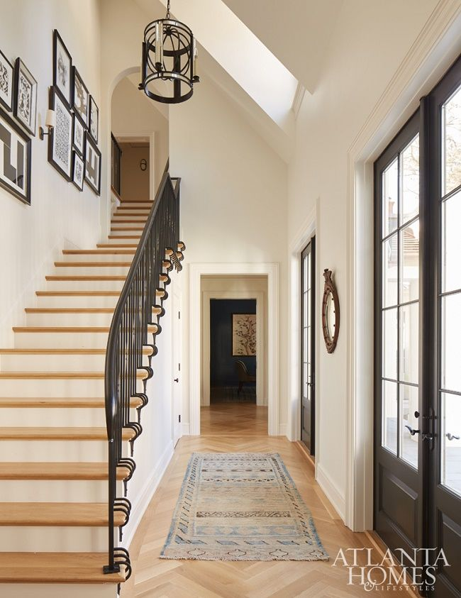 Designer: Andrew Howard - steel doors, iron railings, natural wood floors