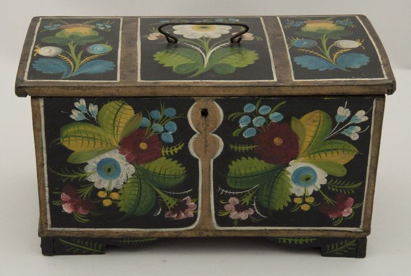Norwegian box of nailed construction in the style of large trunks. Rosemaling on exterior and interior.