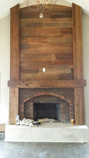 We reworked this big brick fireplace with a 9\u0027 hand hewn mantle, big