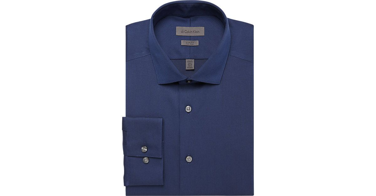 856a30d839e9 Calvin Klein Midnight Blue Slim Fit Non-Iron Dress Shirt from  MensWearhouse. #MensWearhouse