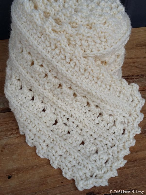 Rolled up, it\'s a lacy super scarf cake. Tie a ribbon around it, and ...