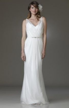 Amy Kuschel Bride's wedding dress style Ashbury is a white, v-neck neckline, sheath, floor-length gown. This bohemian bridal dress may just be the one!