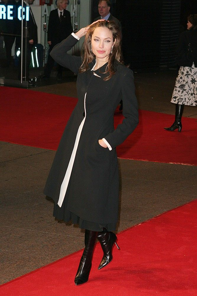 """For the """"Alexander"""" London premiere, Angelina chose a simple black coatdress, and looked stunning."""