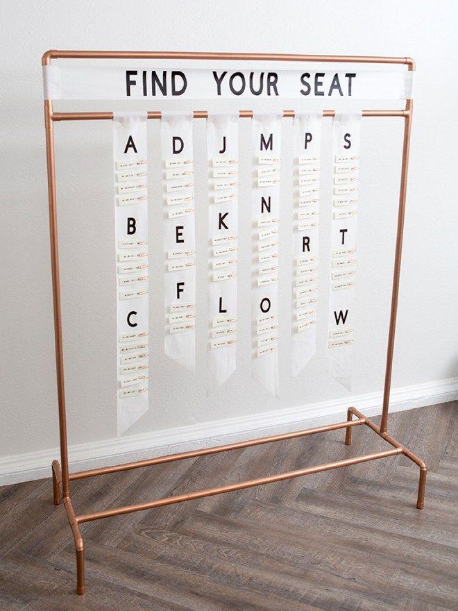 This DIY copper pipe seating card display