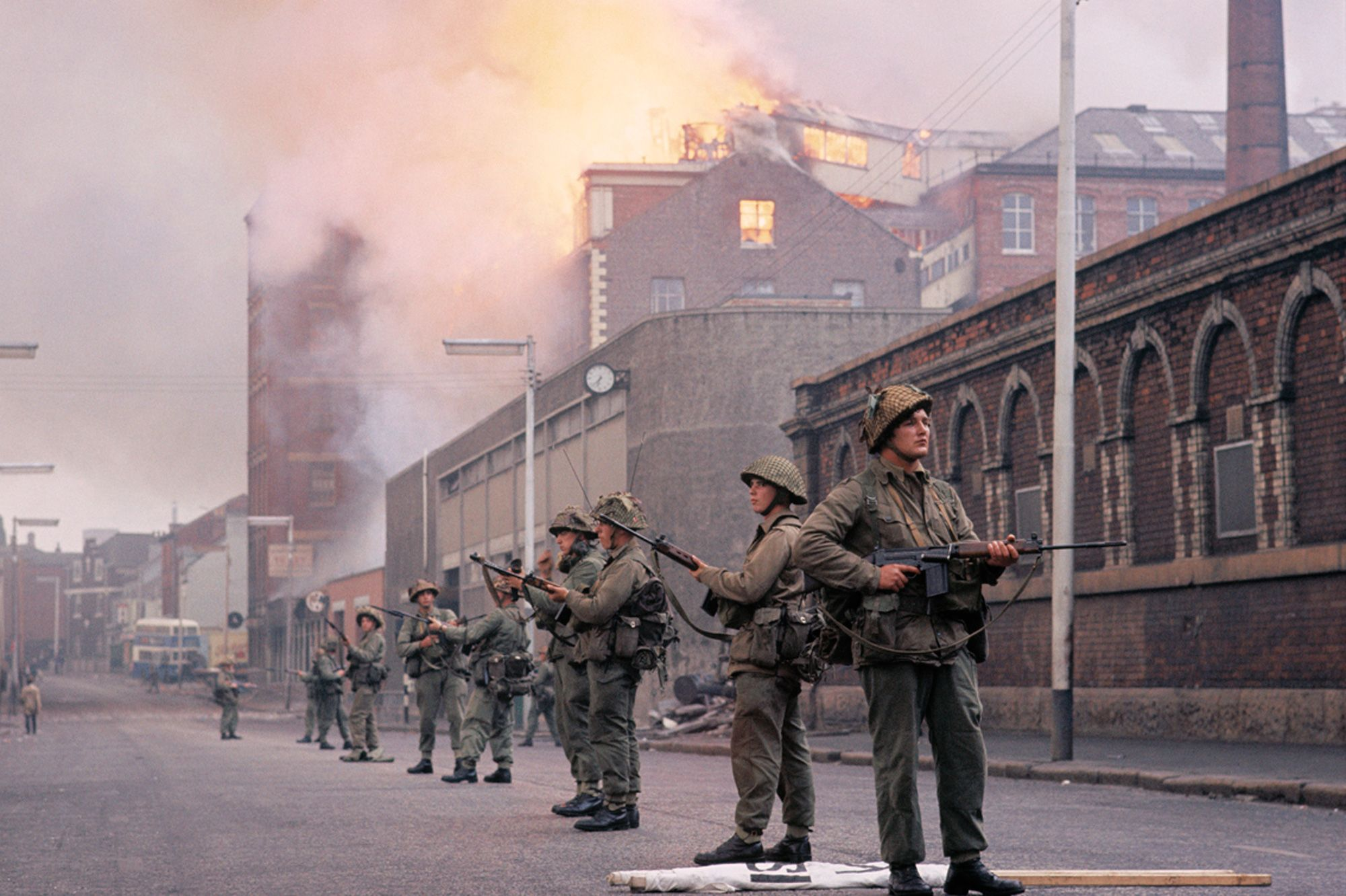 57fed2a1ad British Army soldiers stand in front of a burning building during the Northern  Ireland riots of August 1969