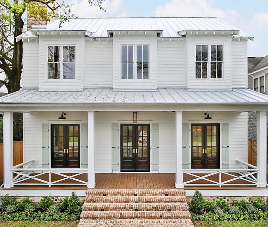 White Exterior With White Windows Trim House Siding And Gray Metal Roof Soft Gray Green Blue Shutters White Exterior Houses House Exterior Metal Roof Houses