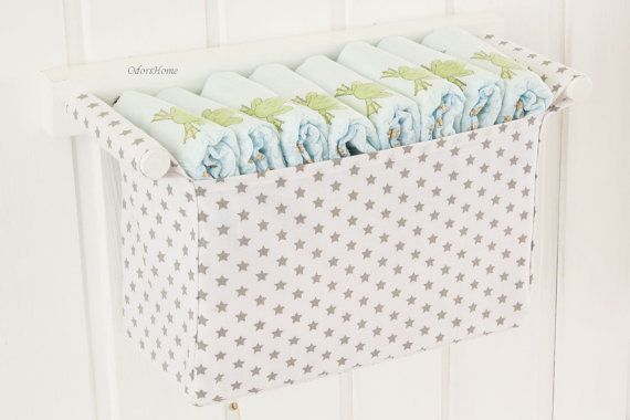 Wall mounted diaper storage for grey and white baby nursery room, gray stars, baby shower gift