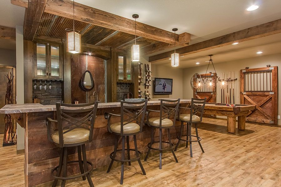 This basement combines rustic and luxury materials to create an eclectic and rich looking space - Rustic bar ideas for basement ...