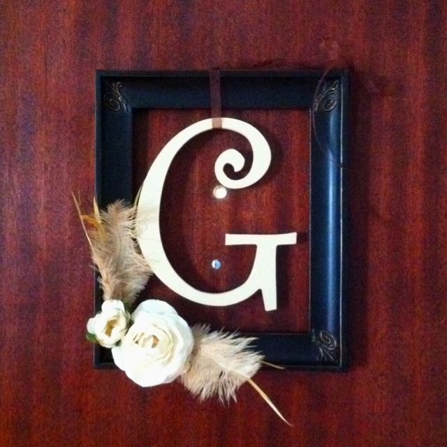 "This is a combination of ideas I've seen all over Pinterest. I'm pretty impressed with myself even though it was super easy. All supplies are from hobby lobby. I just cut the flowers and feathers off the stems and hot glued them to the frame, spray painted the ""G"" and tied it to the frame with ribbon. If I can do it, anyone can!"