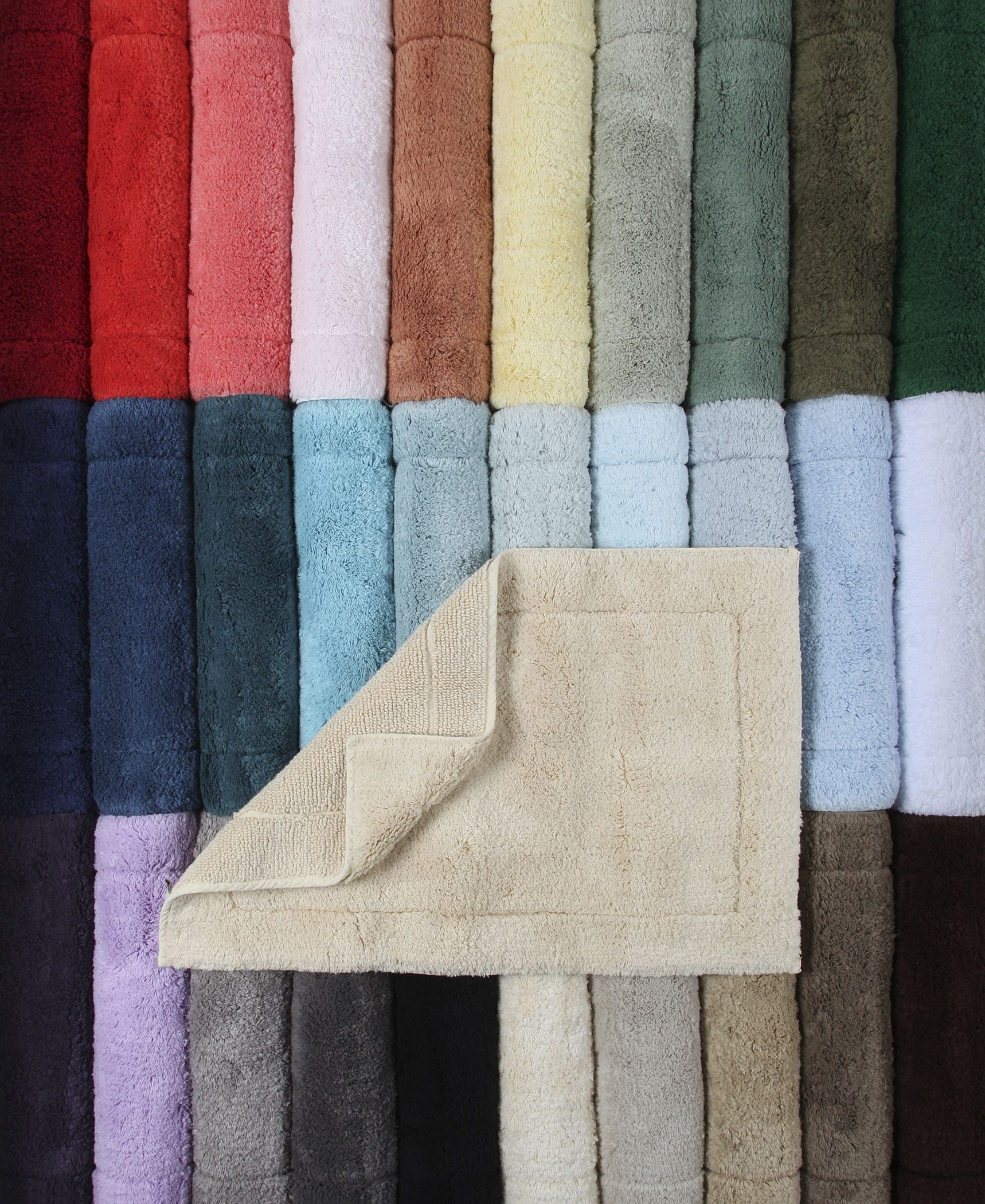 Crafted in a century-old mill in Portugal, this reversible bath rug provides incomparably soft, cushioned comfort.