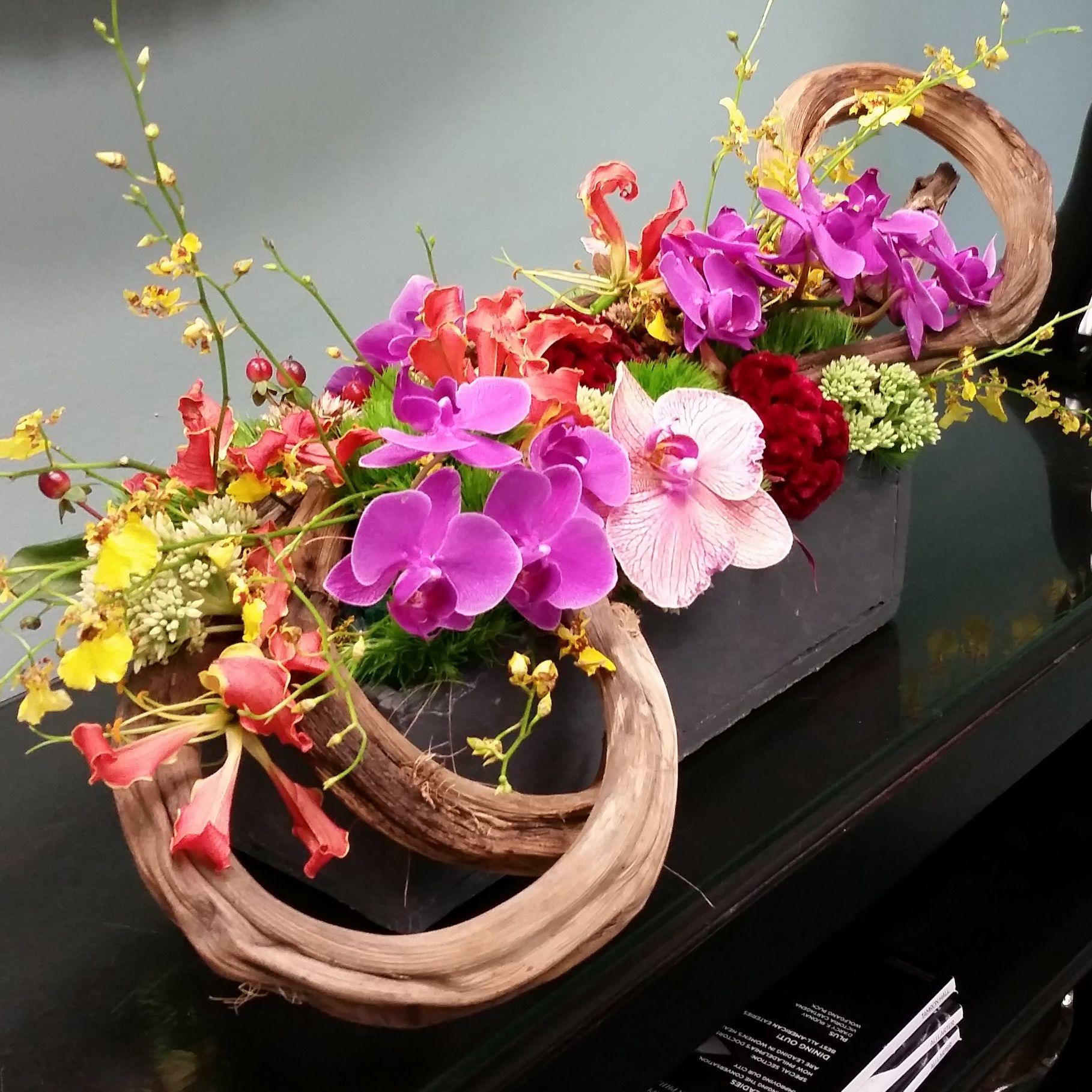 Modern Flower Arrangement Of Orchids Celosia And Curly Wood Branches Modern Flower Arrangements Flower Arrangements Modern Flower