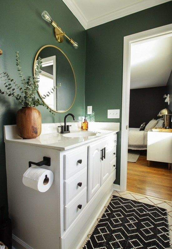 Photo of dark green modern boho bathroom
