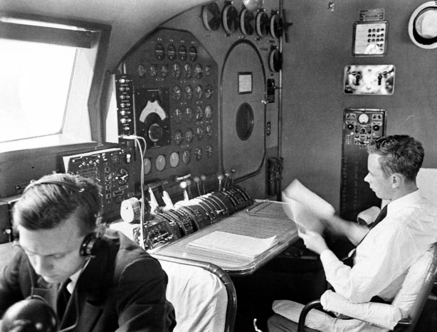 The Flight Engineer's station on the upper (or: 'Flight') deck of a Pan American Airways Boeing B-314 Clipper flying boat. The Flight Engineers were responsible for not only monitoring the numerous systems on the aircraft, but for tracking fuel consumption in flight. FEs kept a 'Howgozit' flow chart that allowed the FE to know at any given moment if the fuel consumption was behind or ahead of schedule.