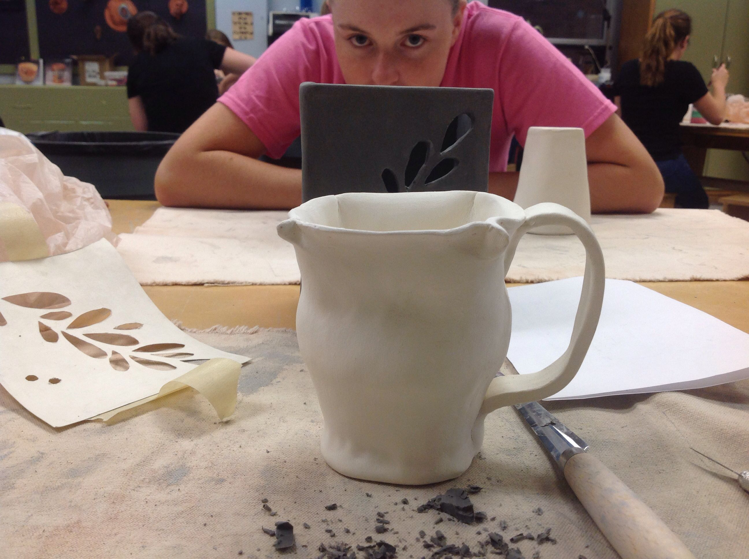 My mug before glazing and I like it a lot more than before it was fired