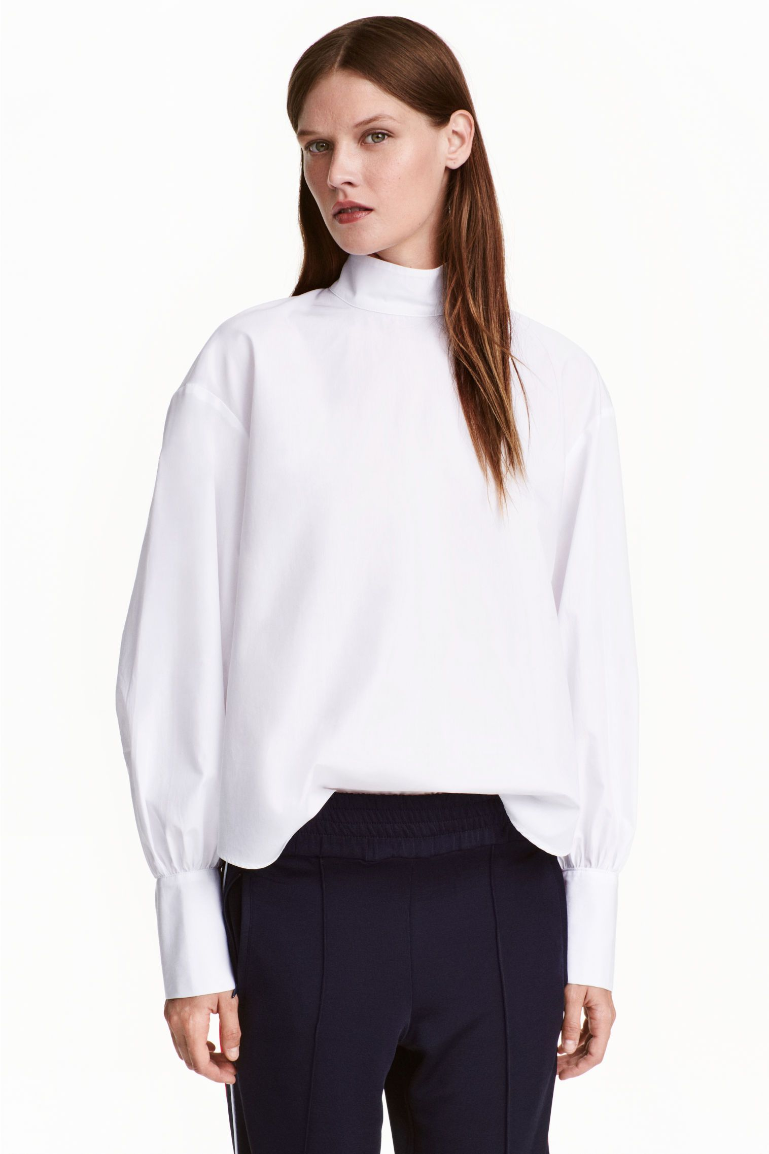 wide cotton blouse with turtleneck and cuff sleeves