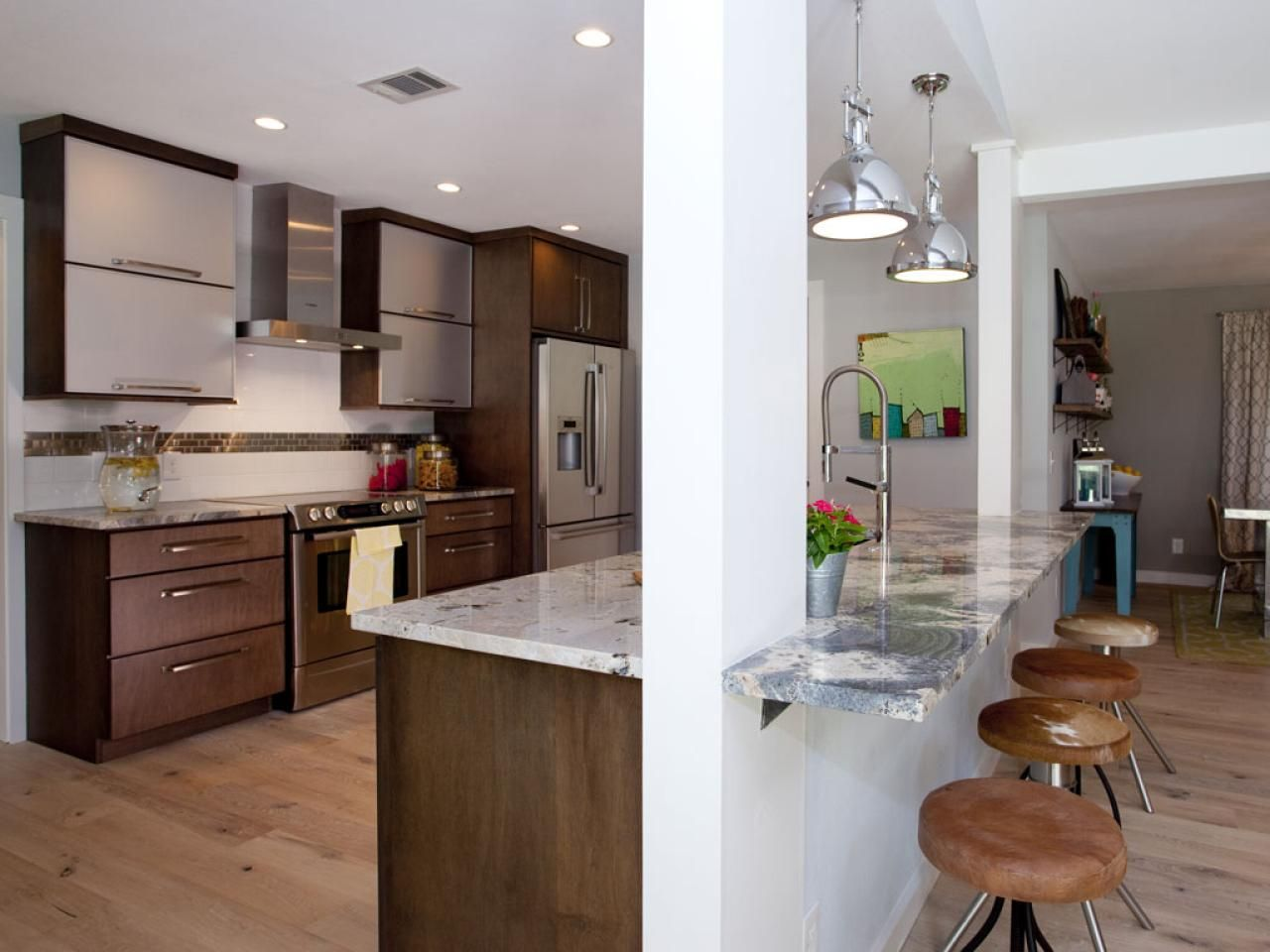 Room Transformations From The Property Brothers Maple Cabinets Breakfast Bars And Hgtv