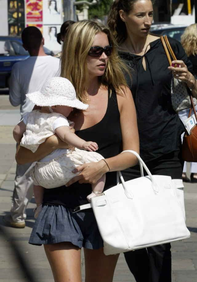 8bd11306f750 Model Kate Moss walks with her daughter Lola and a Birkin bag in 2003.  Photo…
