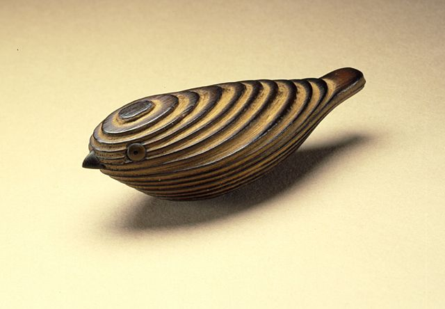 Japan  Abstract Bird, 19th century  Netsuke, Cryptomeria or cedar wood with inlays, 2 9/16 x 15/16 x 7/8 in. (6.6 x 2.4 x 2.2 cm)  Raymond and Frances Bushell Collection (M.87.263.129)  Japanese Art Department.  LACMA Collections Online