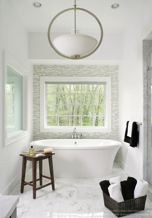 Beautiful master bathroom with a freestanding tub ...
