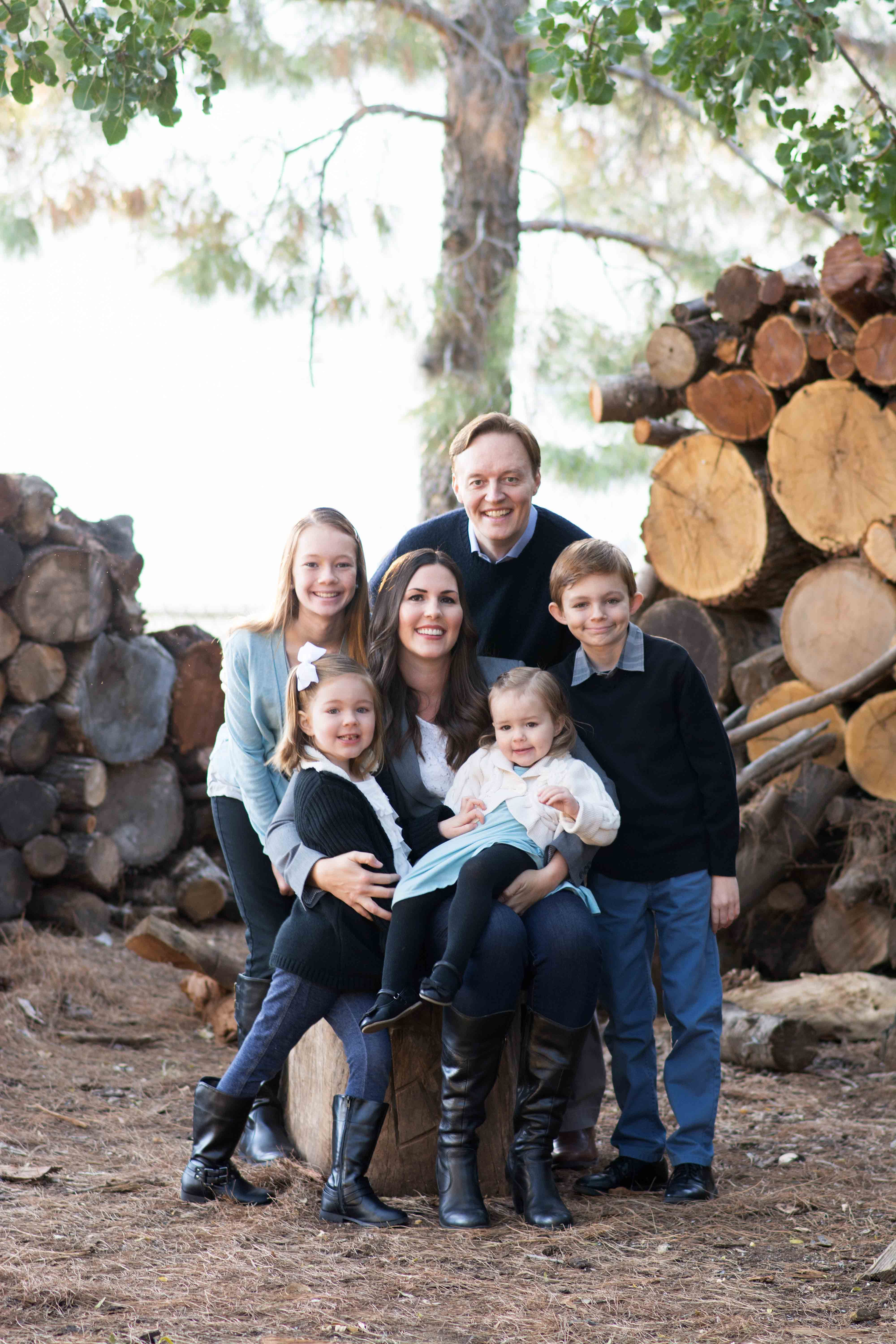 Family wearing black and blue for rustic fall family portraits in gilbert az