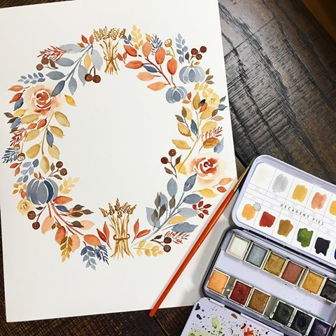 Beautiful watercolor wreath by Spoonflower designer sweetseasonsart.  Hand painted watercolor floral wreath with fall colors. #fallcolors