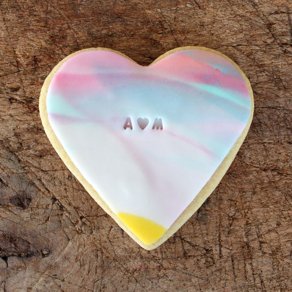BKD make all sorts of bespoke biscuits for events, parties, for big kids, little kids, weddings.  #biscuits #cookies #heart #tiedye #tiedyeheart #heartcookie #ombre #wedding
