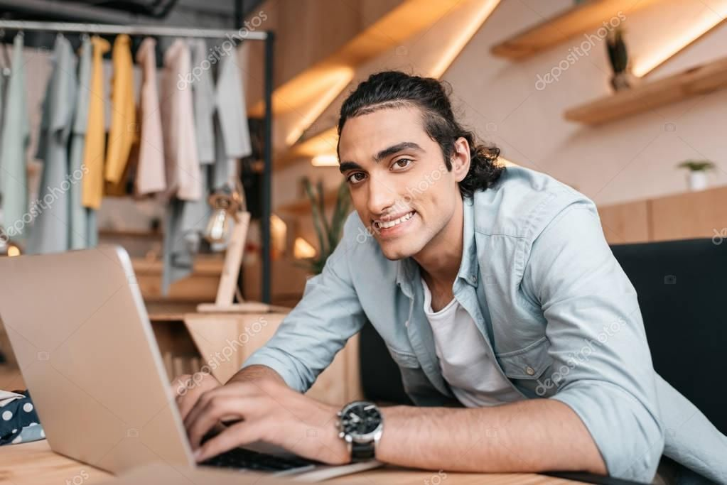 Business owner using laptop  Stock Photo