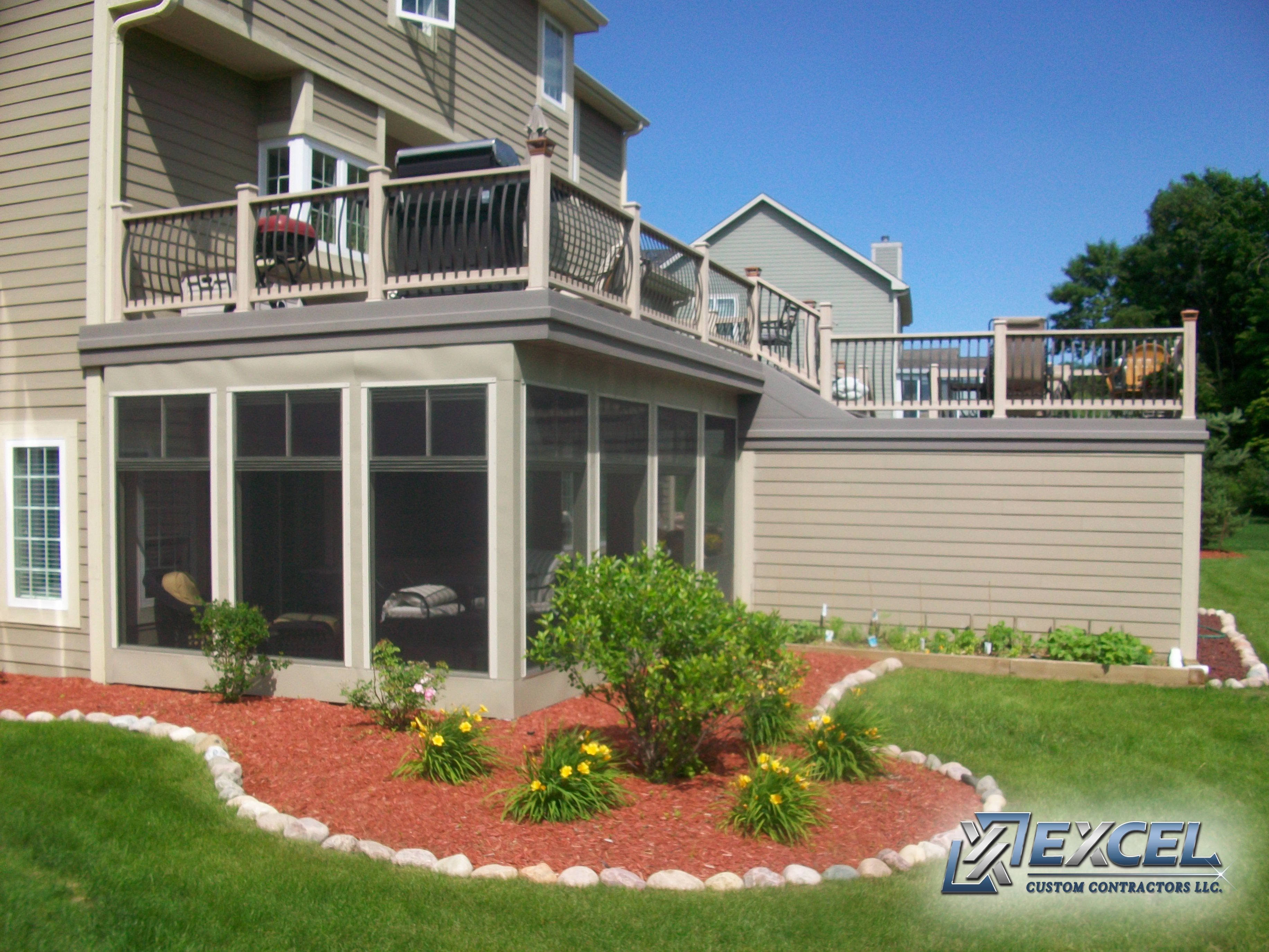 A custom sunroom with a multi leveled deck above for Home sunrooms